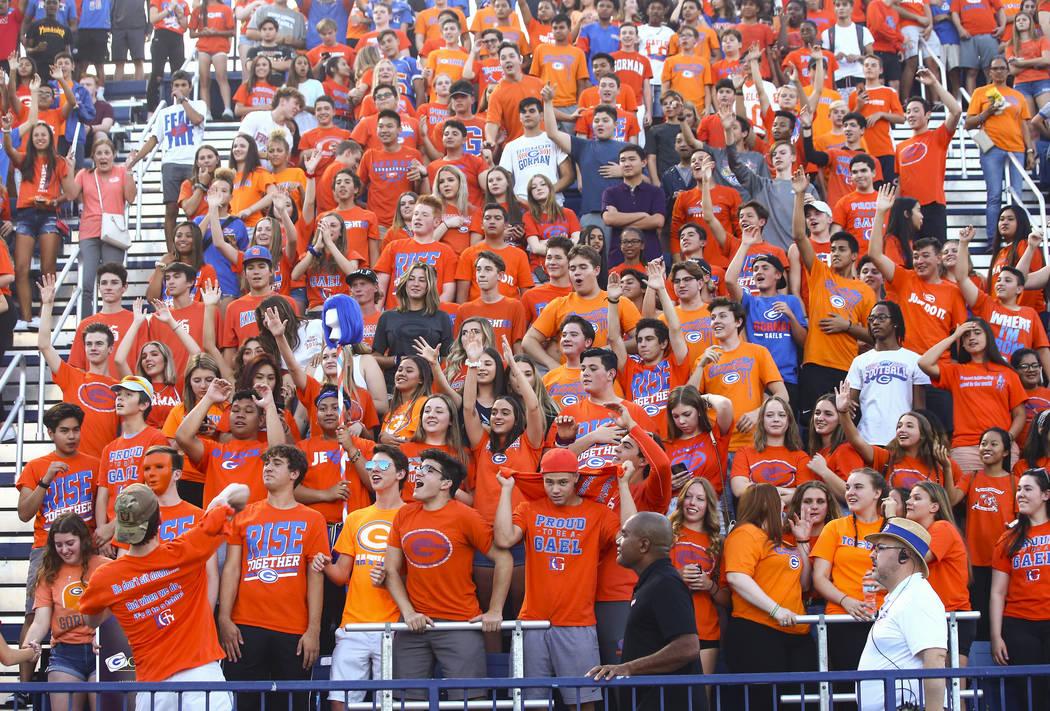 Bishop Gorman students cheer before the start of a football game against Orem at Bishop Gorman ...