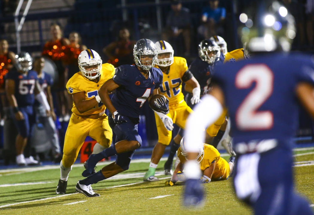 Bishop Gorman's Rome Odunze (4) runs the ball against Orem during the second half of a football ...