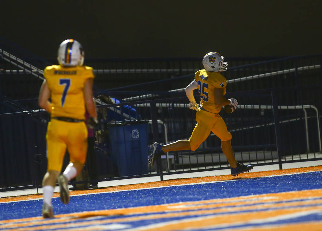 Orem's Brinton Paulson (25) scores against Bishop Gorman during the second half of a football g ...