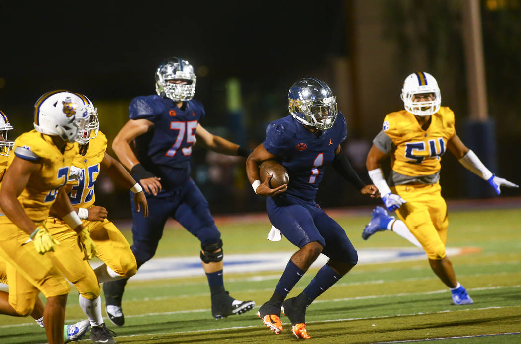 Bishop Gorman's Micah Bowens (1) runs the ball against Orem during the second half of a footbal ...