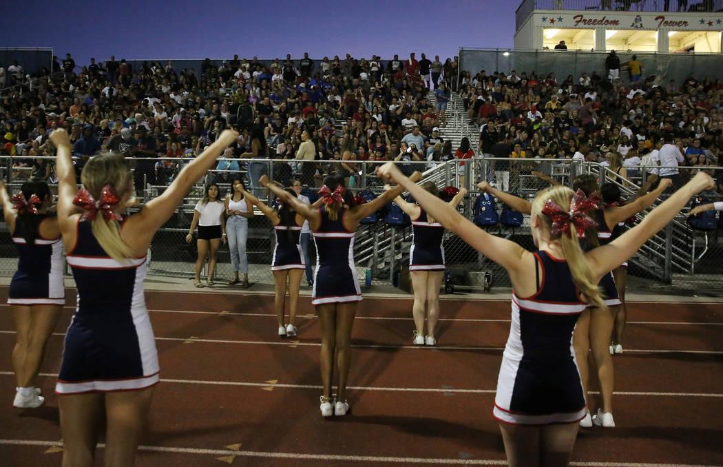 The Liberty High school cheerleaders perform during a football game against Chandler, Ariz., Hi ...