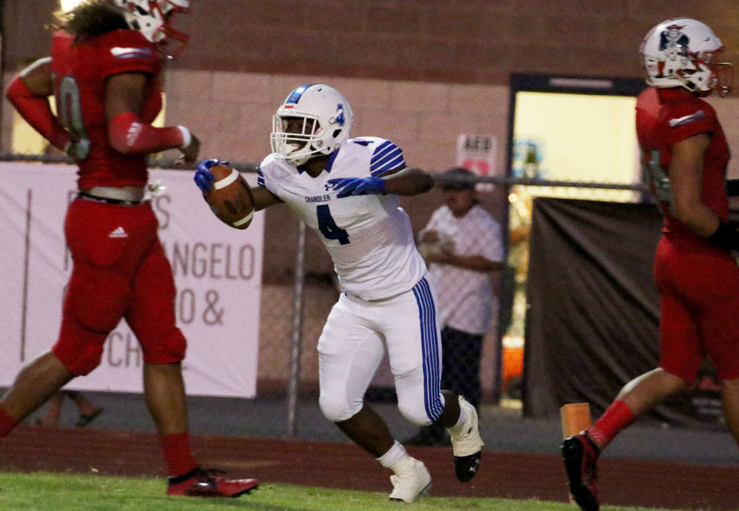 Chandler, Ariz., High's Dae Dae Hunter celebrates his touchdown during the first half of their ...