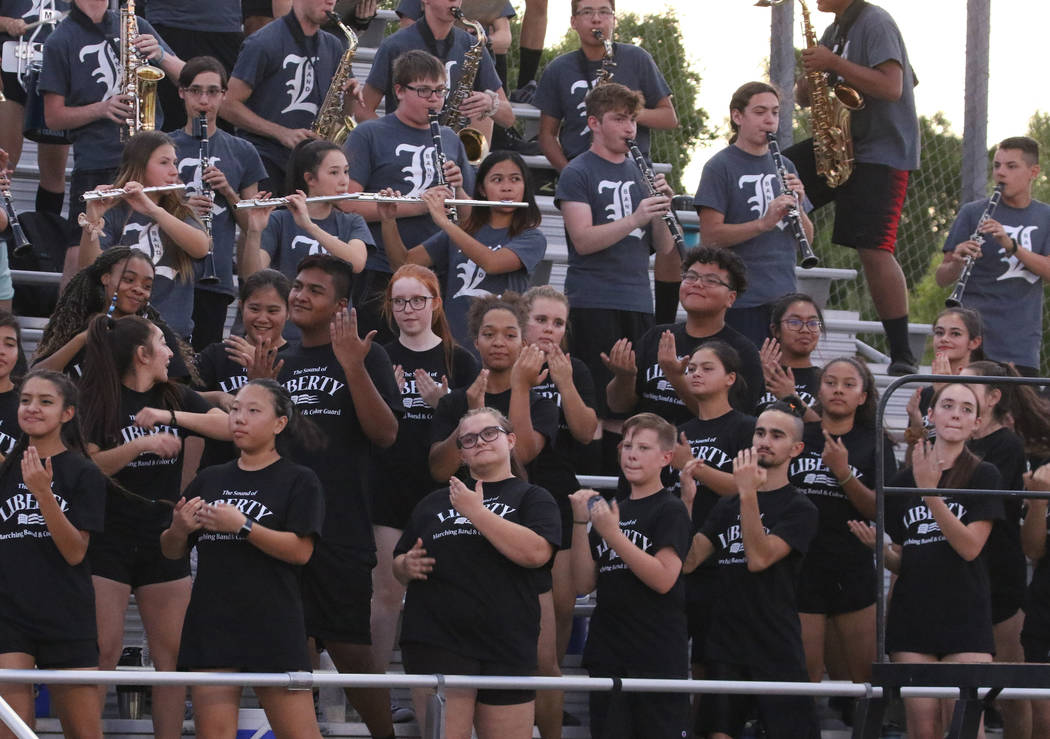 The Liberty High marching band perform during a football game against Chandler, Ariz., High Sch ...