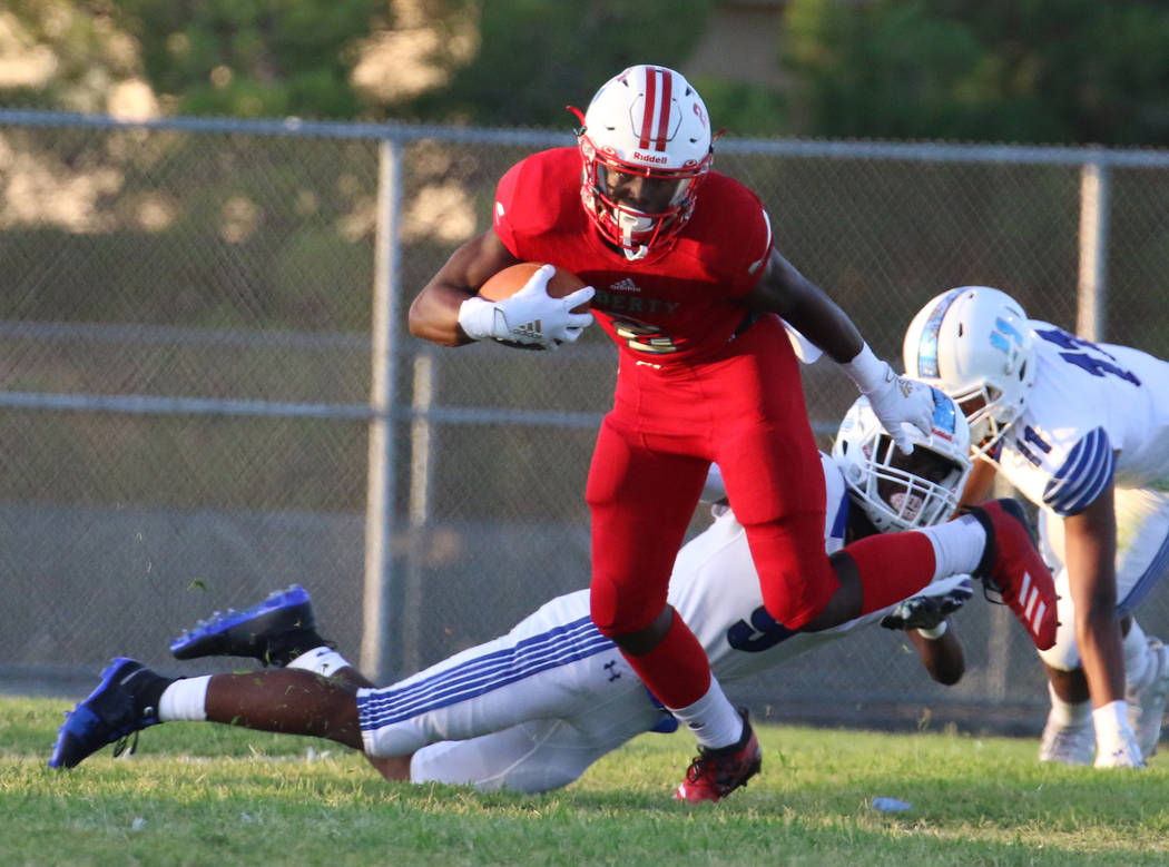 The Liberty High's wide receiver Germie Bernard (2) scrambles away from Chandler, Ariz., High's ...
