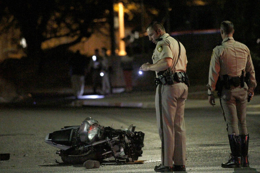 Las Vegas police officers investigate a fatal motorcycle accident at Martin Luther King Bouleva ...