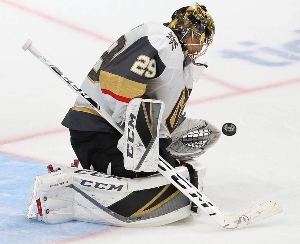 Golden Knights goaltender Marc-Andre Fleury (29) makes a save in the third period during game s ...
