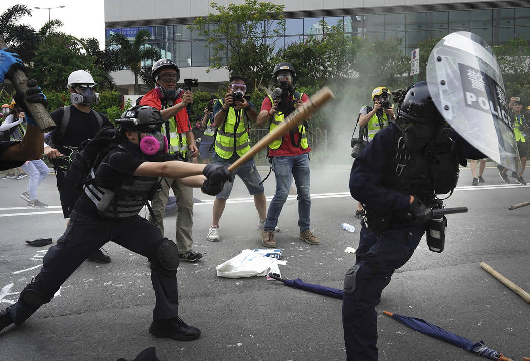 Police and demonstrators clash during a protest in Hong Kong, Saturday, Aug. 24, 2019. Chinese ...