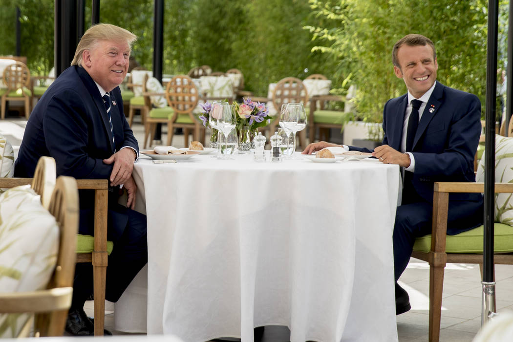 U.S President Donald Trump sits for lunch with French President Emmanuel Macron, right, at the ...