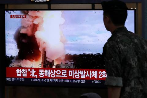 A South Korean soldier watches a TV screen showing a news program reporting about North Korea's ...