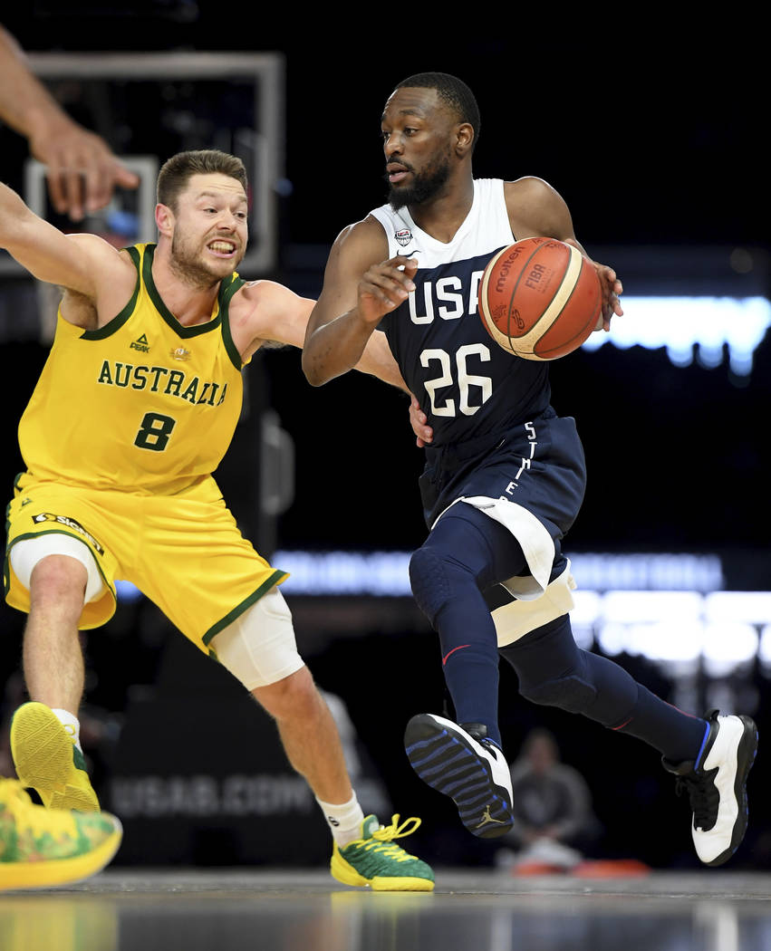 Australia's Matthew Dellavedova, left, and United States' Kemba Walker in action during their e ...
