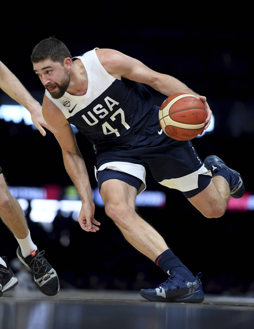 United States' Joe Harris in action against Australia during their exhibition basketball game i ...