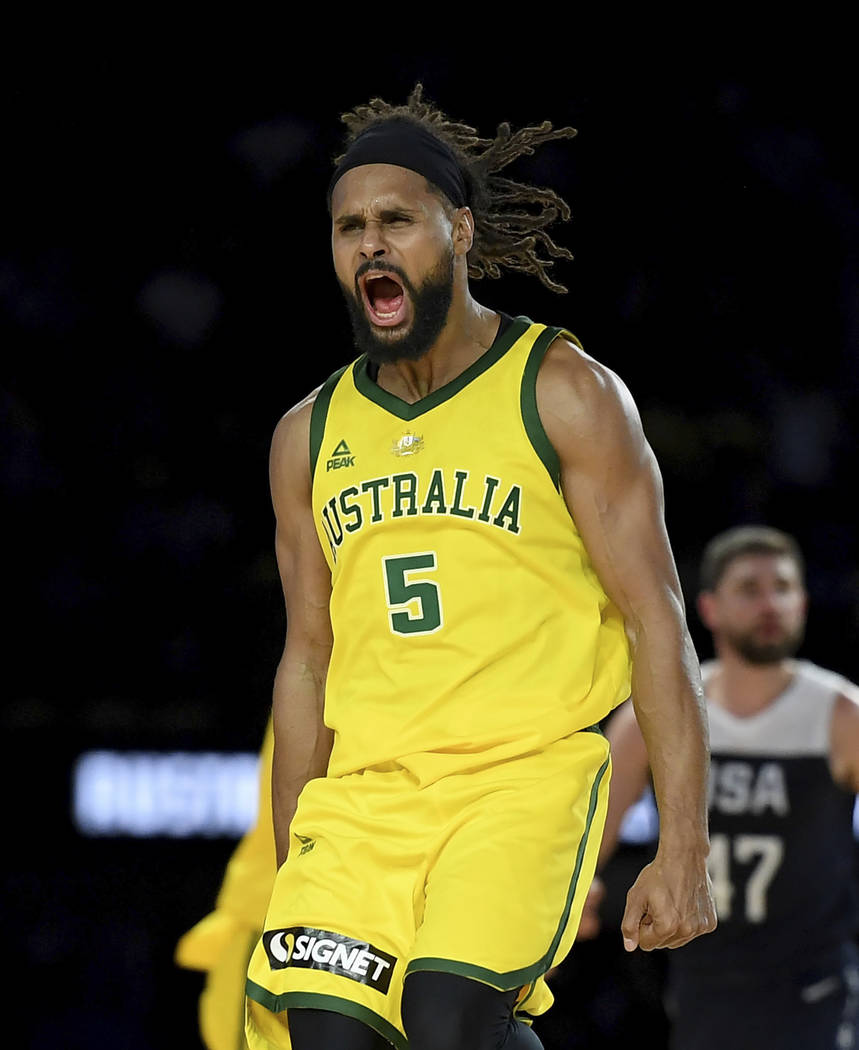 Australia's Patty Mills celebrates after shooting a 3-pointer during their exhibition basketbal ...