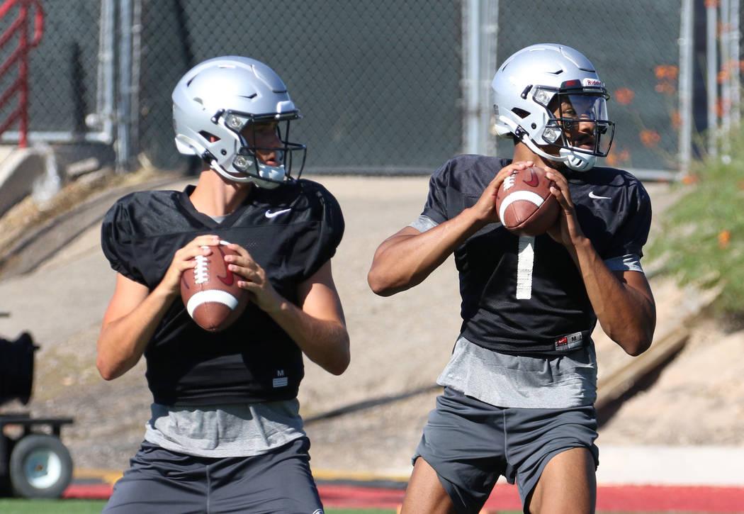 UNLV Rebels quarterbacks Kenyon Oblad, left, (7) and Armani Rogers (1) prepare to throw balls d ...