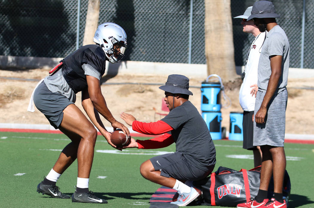 UNLV Rebels quarterback Armani Rogers (1) during a drill at team practice on Tuesday, Aug. 13, ...