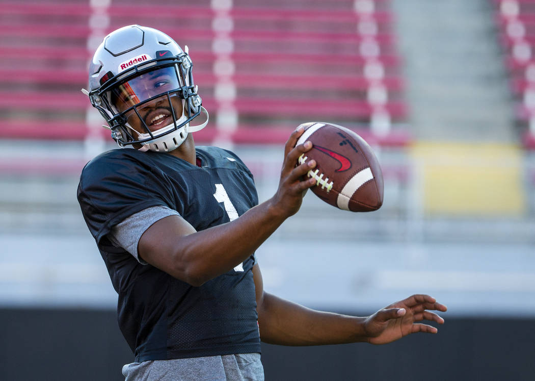 UNLV QB Armani Rogers (1) looks to make a a toss to his running back during their first major s ...