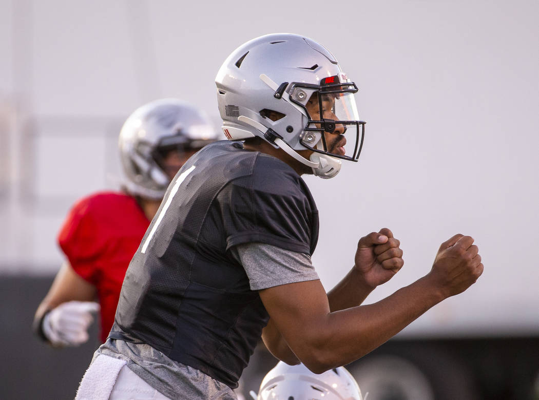UNLV QB Armani Rogers (1) calls a play during their first major scrimmage of football training ...