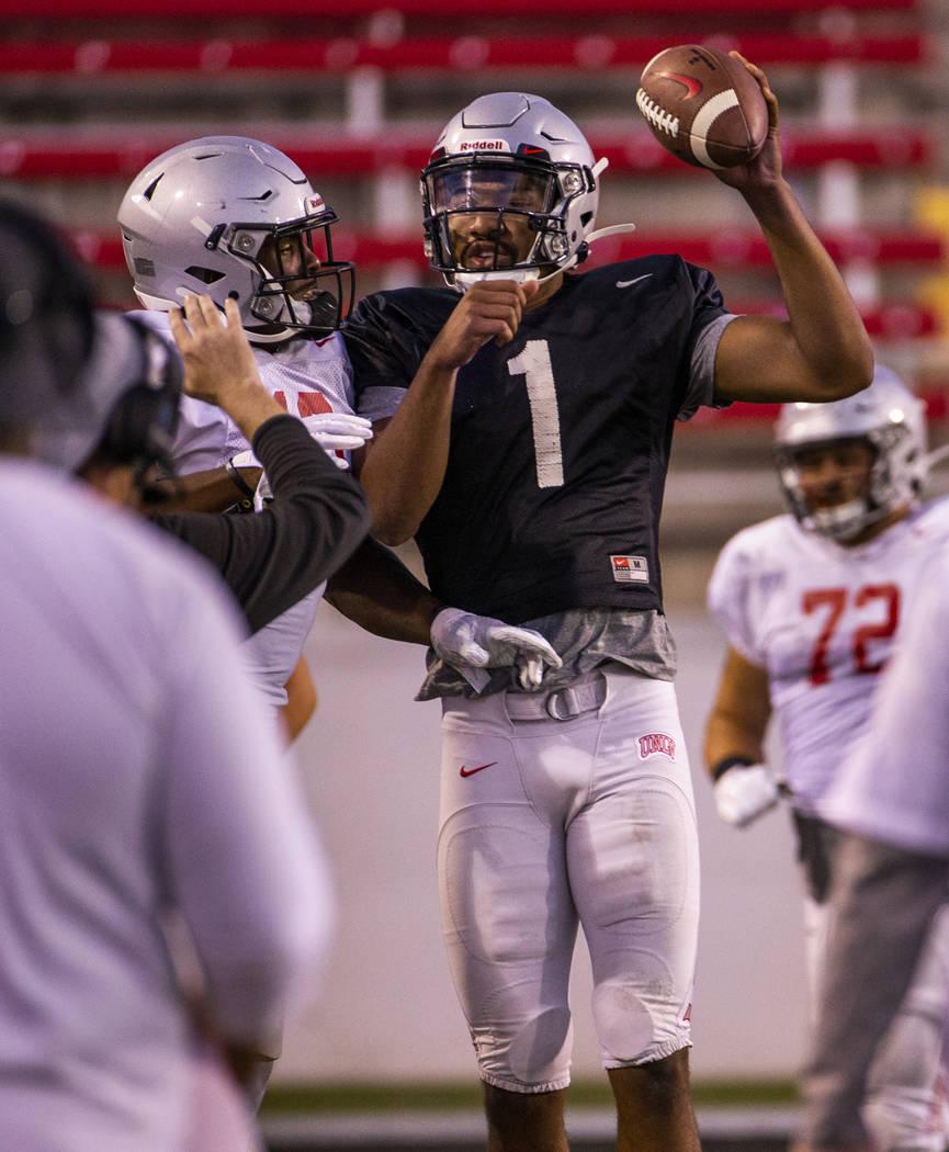 UNLV QB Armani Rogers (1) celebrates a touchdown run with a teammate during their first major s ...
