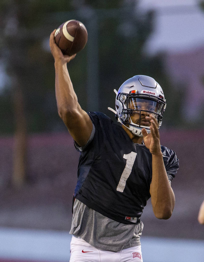 Quarterback Armani Rogers (1) readies to pass to a receiver during the UNLV football team scrim ...