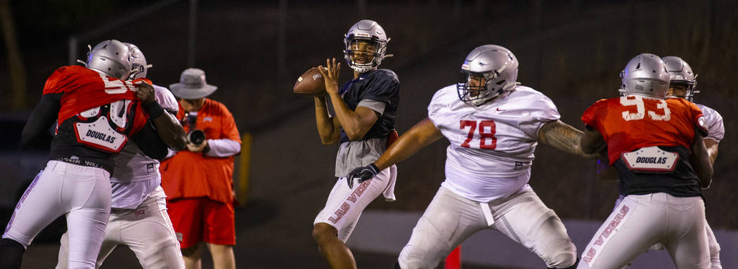 Offensive lineman Justin Polu (78, right center) helps to defend quarterback Armani Rogers (1, ...