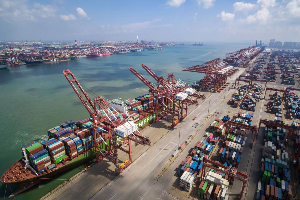 In this Aug. 6, 2019, photo, a container ship is docked a port in Qingdao in eastern China's Sh ...