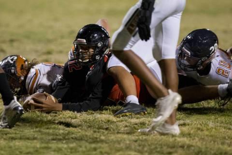 Las Vegas sophomore quarterback Ja'Shawn Scroggins (12) extends for a touchdown past Legacy def ...