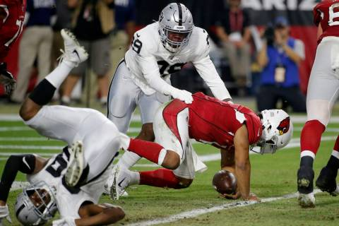 Arizona Cardinals quarterback Kyler Murray (1) is tackled in the end zone for a safety by by Oa ...