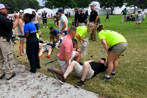 Spectators are tended to after a lightning strike on the course left several injured during a w ...