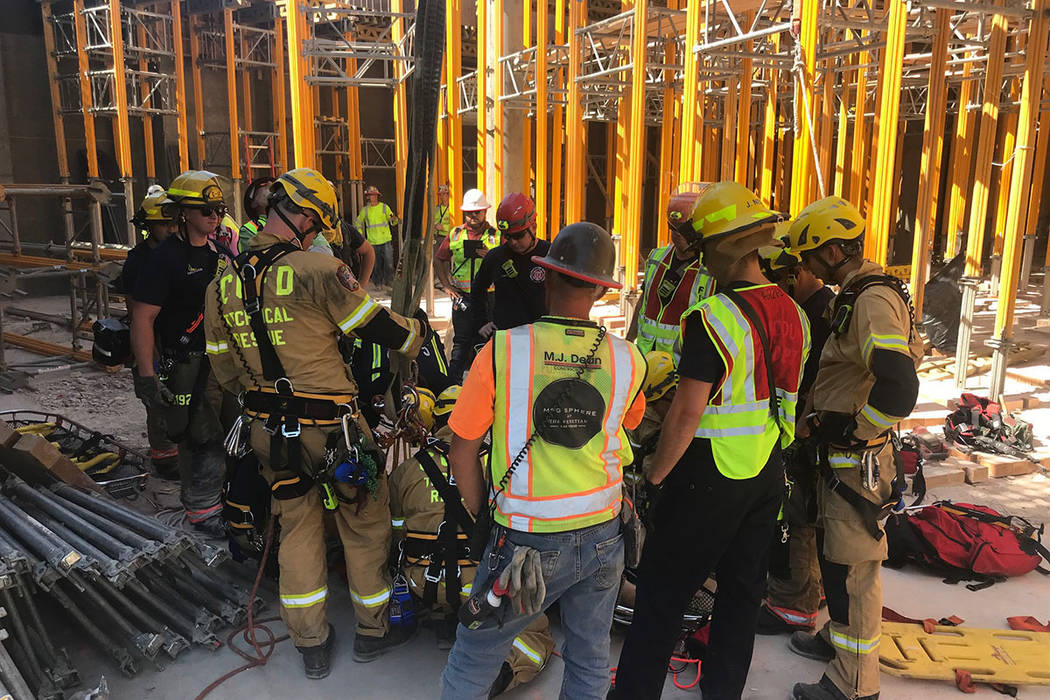 A member of the Clark County Fire Department helps with a rescue of a construction worker Satur ...