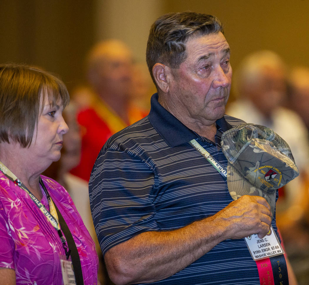 Veteran Jens Larsen, right, and his spouse Kerry stand during a benediction for those who serve ...
