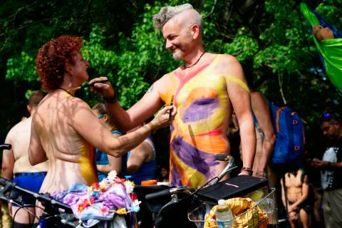 In this photo provided by David Cimetta, Melanie and Jim OâConnor paint each other's nude ...