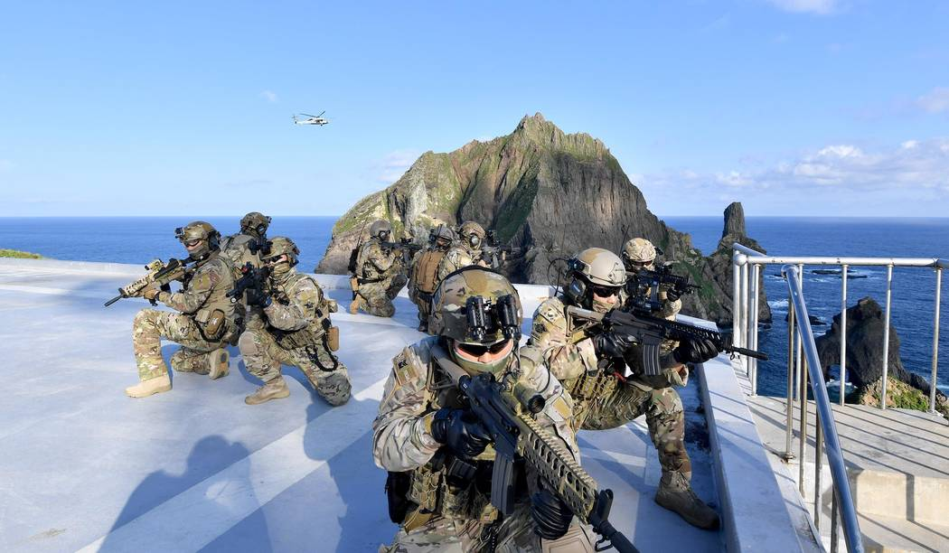 In this photo provided by South Korea's Navy, members of South Korean Navy's special forces par ...