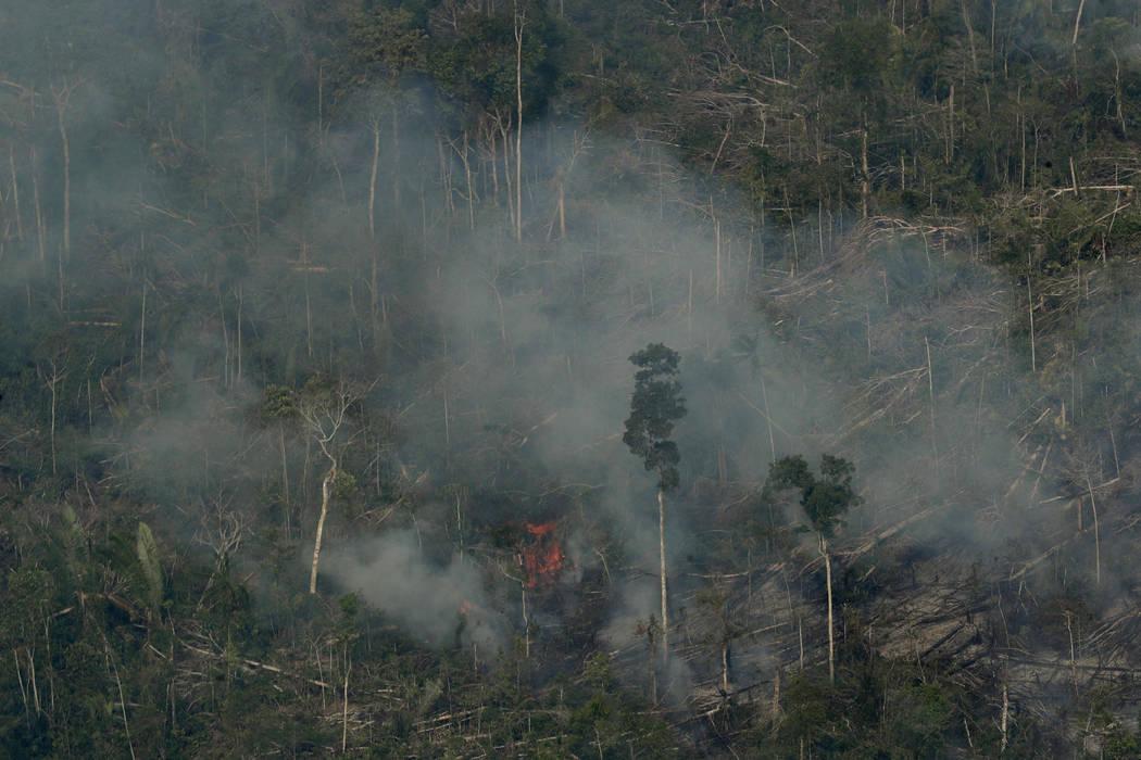 Fire consumes an area near Jaci Parana, state of Rondonia, Brazil, Saturday, Aug. 24, 2019. Bra ...