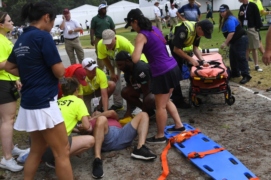A spectator is tended to after a lightning strike left several injured during the third round o ...