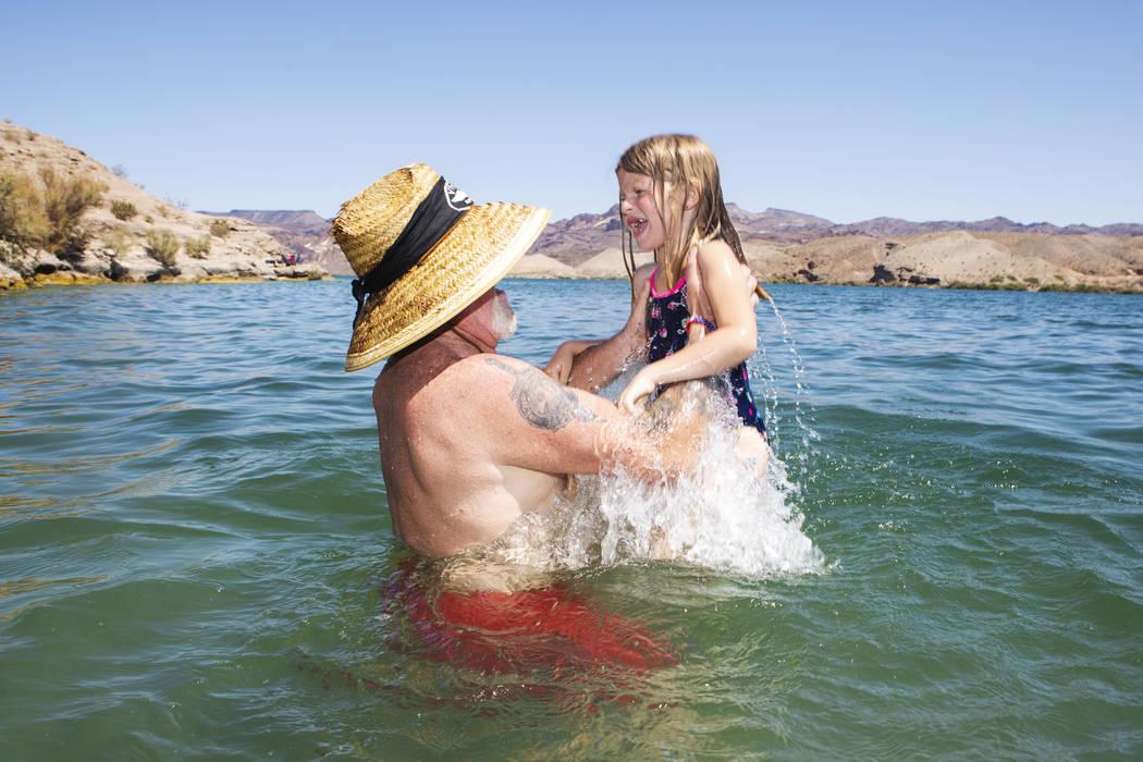 Glenn Cogle picks up his partners granddaughter Emily Howe, 6, in Lake Mohaveʡt Nelson's ...