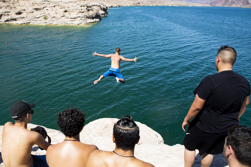 Matt from Las Vegas, who choose not to give this last name, jumps high into Lake Mohaveʡt ...