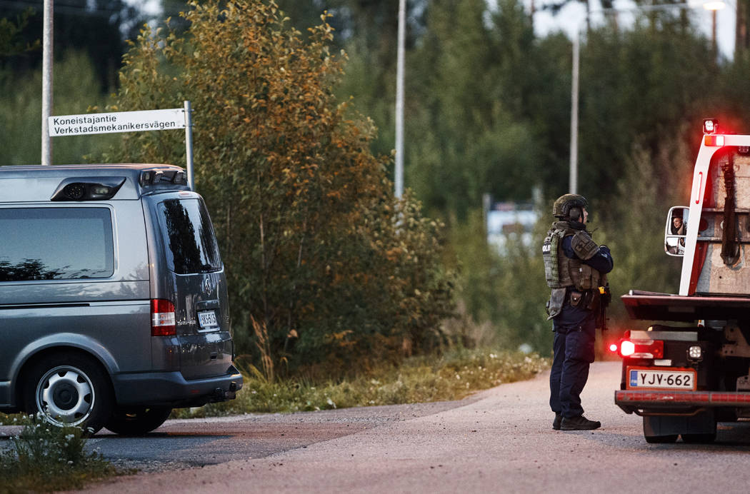 Police investigate an incident in an industrial area near Porvoo, Finland, early Sunday Aug. 25 ...
