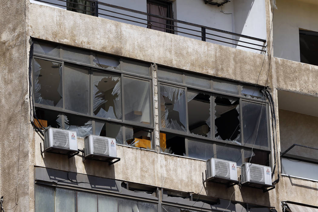 Broken windows are seen on the 11-floor building that houses the media office in a stronghold o ...