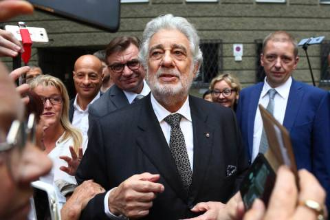 Placido Domingo talks to fans at the 'Festspielhaus' opera house after he performed 'Luisa Mill ...