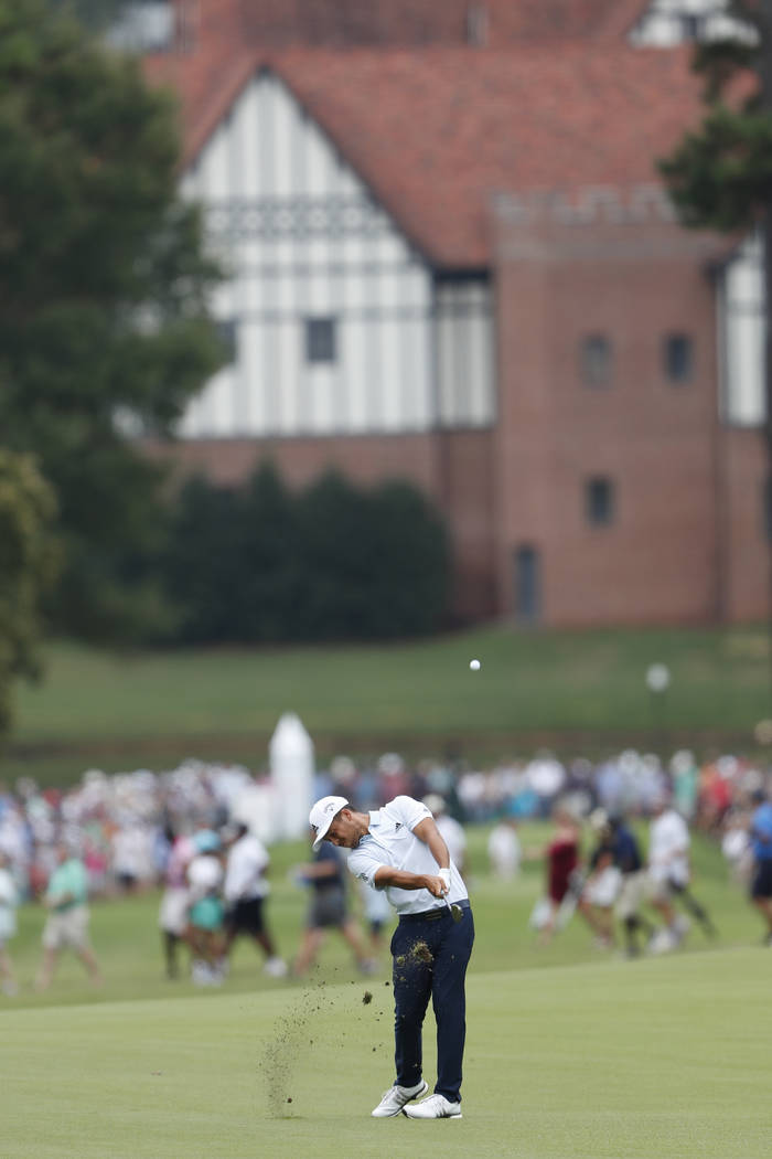 Xander Schauffele hits from the fourth fairway during the final round of the Tour Championship ...