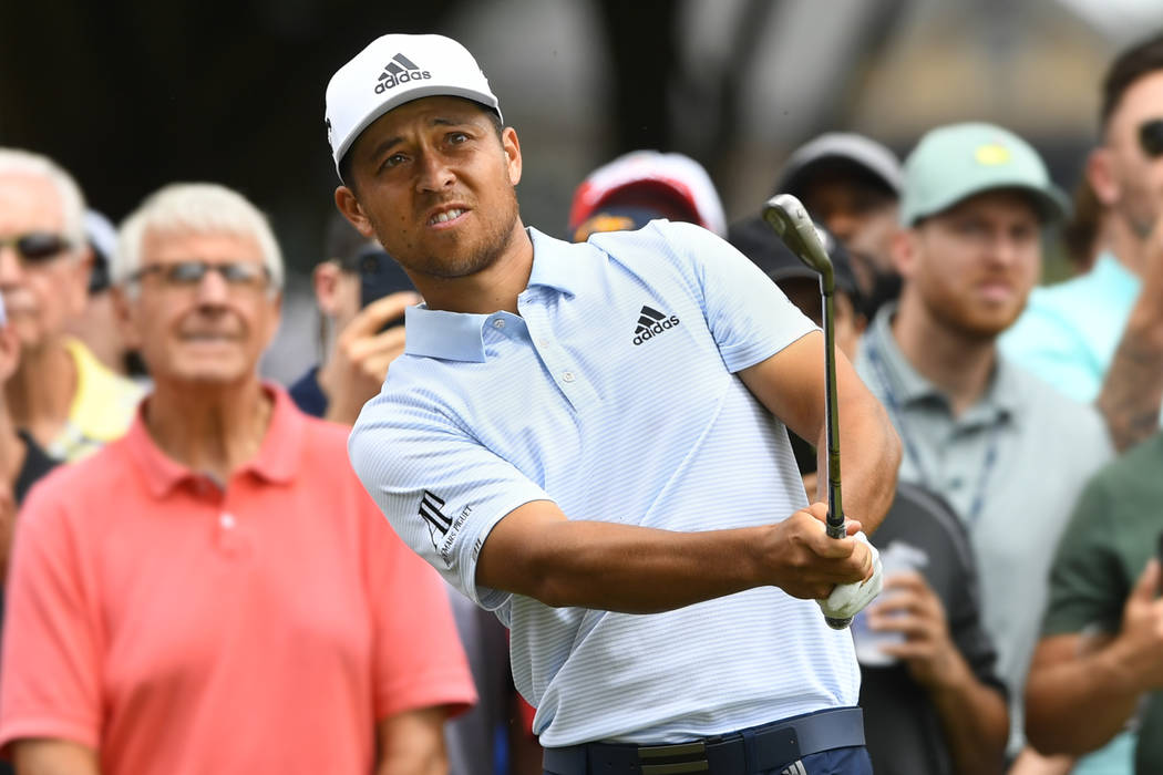 Xander Schauffele hits to the fifth green during the final round of the Tour Championship golf ...