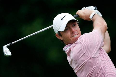 Rory McIlroy hits from the tee on the 11th hole during third-round play in the Tour Championshi ...