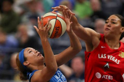 Minnesota Lynx forward Napheesa Collier, center, is fouled by Las Vegas Aces center Liz Cambage ...