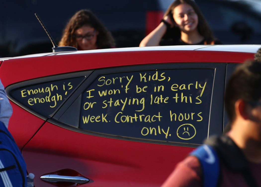 """A note """"Contract Hours Only'' written on the side windows of a teacher car is seen as teac ..."""
