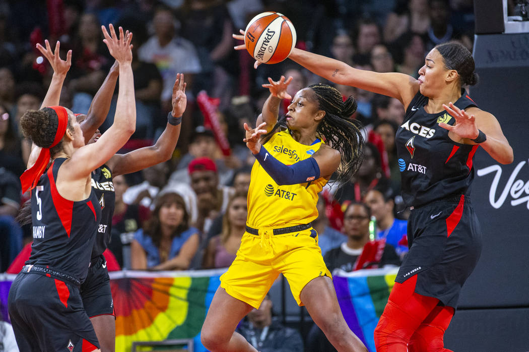 Indiana Fever guard Kelsey Mitchell (0) has a pass deflected by Las Vegas Aces center Liz Camba ...