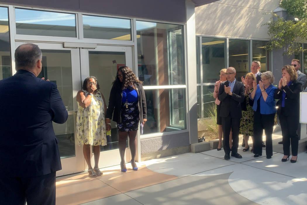 Gail Hudson, left, Hummel Elementary School teacher, is surprised to receive the Nevada Teacher ...