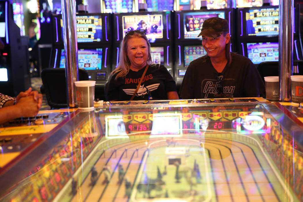 Tammy Beggs, left, and her boyfriend Steve Stefanoff, of Tulsa, Okla., play the Sigma Derby mac ...
