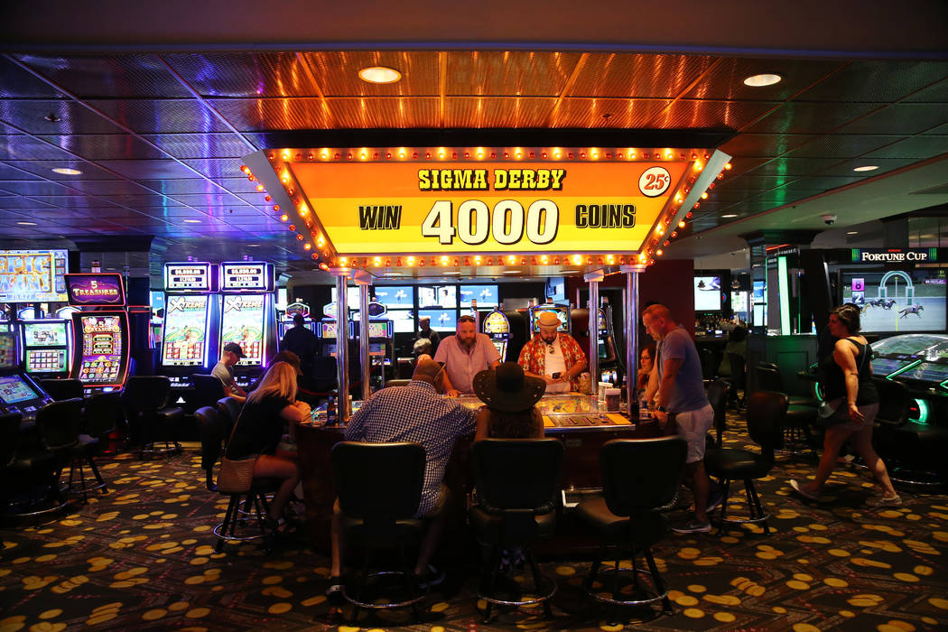 People play the Sigma Derby machine at the D Las Vegas hotel-casino in Las Vegas, Friday, Aug. ...