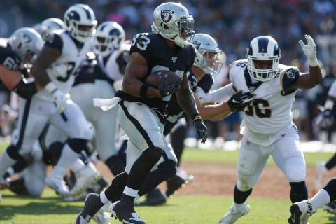 Oakland Raiders' DeAndre Washington (33) runs against the Los Angeles Rams during the first hal ...