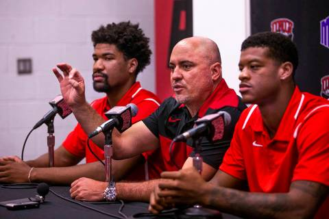 UNLV football head coach Tony Sanchez, center, answers a media question beside quarterback Arma ...