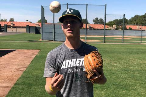 Oakland Athletics rookie pitcher Nathan Patterson tosses a baseball, in Mesa, Ariz. on Friday, ...